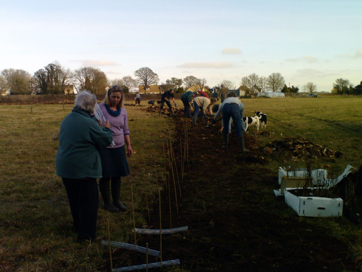 Planting the Edible Hedgerow around the Community Orchard
