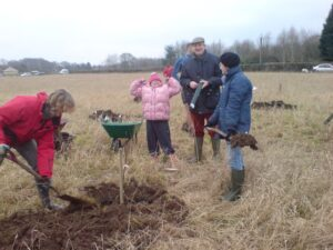 Planting the trees – Lyn Hemming, Kate, Michael and Clare Garrett, Rob Wheeler, Susie Bromley in the background. Photo by Lesley Greene